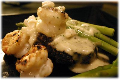 Steak Oscar recipe, grilled beef filet smothered in creamy crab bernaise sauce and grilled shrimp with asparagus.