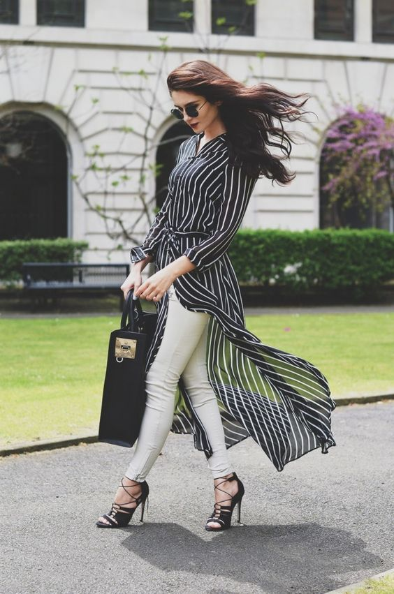 Lolita Masagutova is rocking the long over long trend here, in a floaty striped longline shirt which looks effortlessly stylish worn over pale jeans and with black stilettos! Longline Shirt/Shoes: ASOS, Trousers: ZARA, Bag: Sophie Hulme. Stylish Spring Outfits.