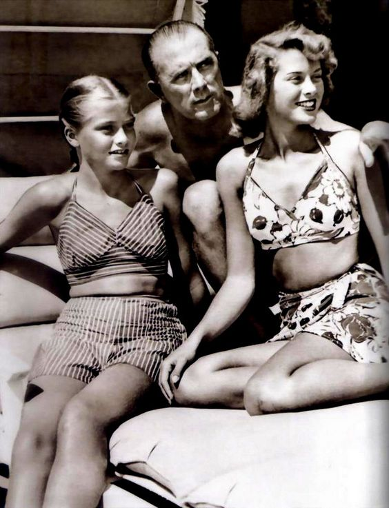 Young Grace Kelly with her dad and sister, Lizzie.:
