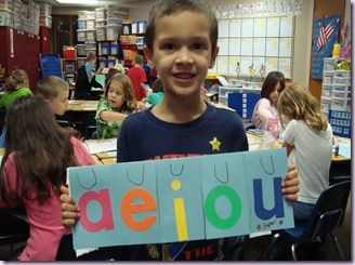 short vowel center; flipbook with kids cutting out mag  pics for sound