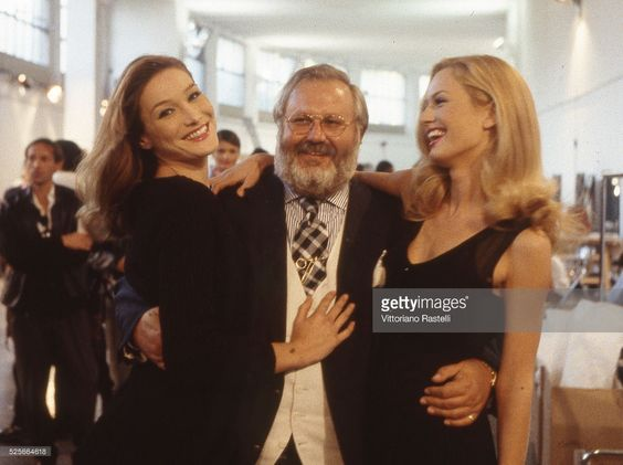 Italian fashion designer Gianfranco Ferre surrounded by Italian-French top model…