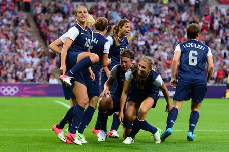 Aug 9, 2012; London, United Kingdom; USA midfielder Carli Lloyd (10) points to her shoe after scoring a goal against Japan during the women's soccer gold medal match in the 2012 London Olympic Games at Wembley Stadium.   Mandatory Credit: Mark J. Rebilas-USA TODAY Sports