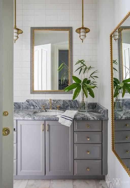 This Stunning Powder Room Features A Gray Washstand Donning Brass