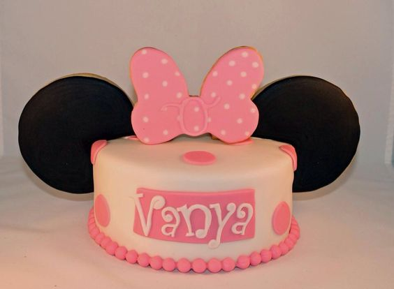 Minnie mouse cake. The ears and the bow are cookies