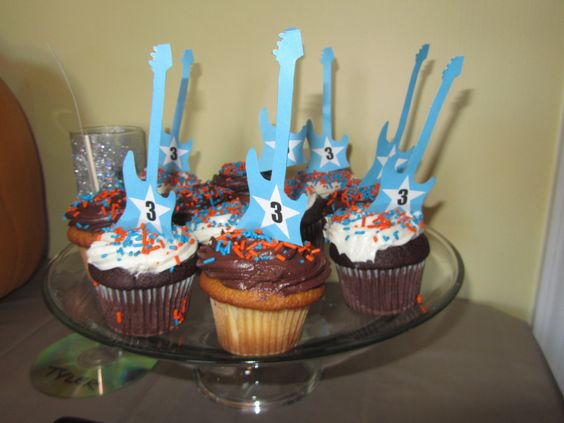 Cupcakes with guitar topper
