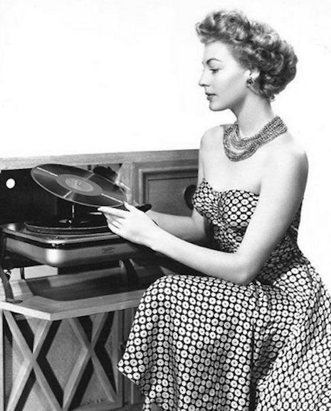 Ava Gardner and her record player, 1949