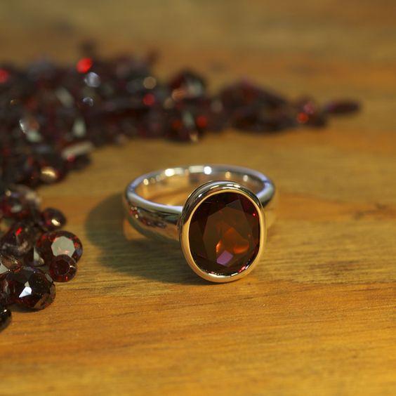 One Ladies Sterling silver custom designed bezel style Garnet ring.