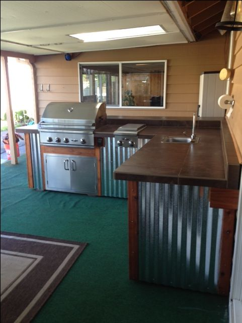 Complete Outdoor Kitchen By Sunset Outdoor Living Llc Wood Corrugated Metal With Stainl Outdoor Kitchen Design Outdoor Kitchen Outdoor Kitchen Countertops