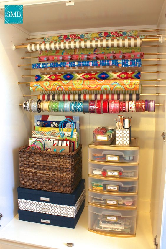 This DIY Wrapping Paper Organizer is a must have for any household! Get your wrapping paper and gift bags organized just before the holidays arrive!