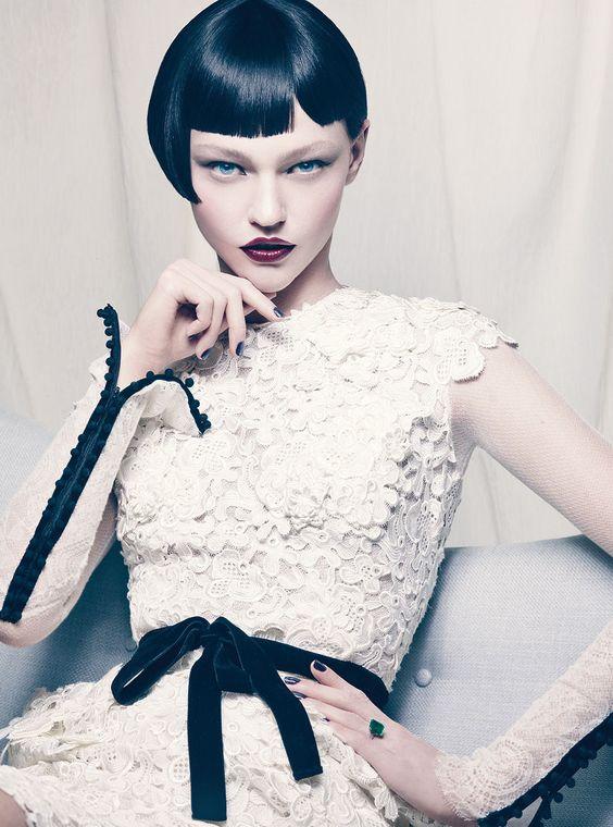 Sasha Pivovarova.  Love everything: the dress, the wig, the emerald ring...
