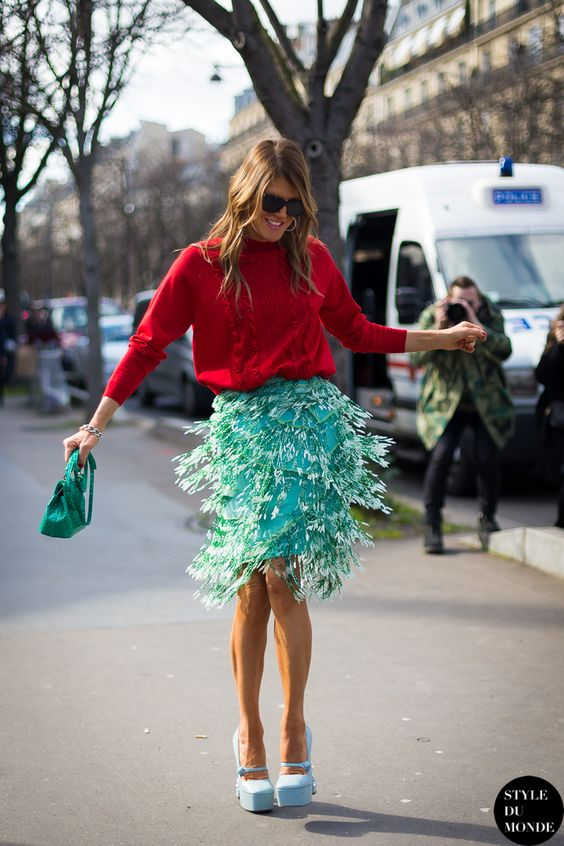 Anna Dello Russo in a bright red sweater and charming green skirt. // #fashion #streetstyle
