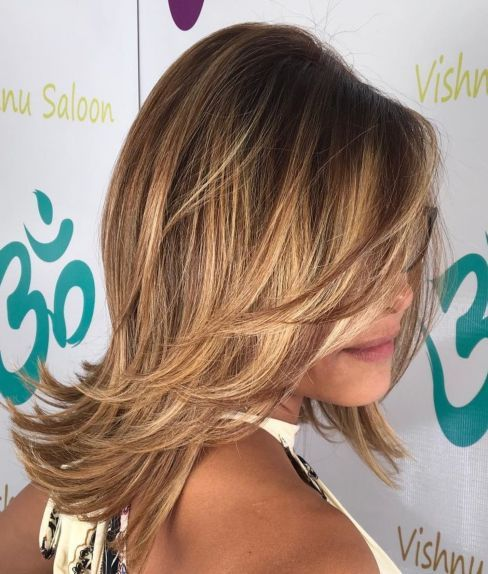 Mid Length Layered Hairstyle With Flicks In 2020 Medium Layered Haircuts Long Hair Styles Mid Length Hair With Layers