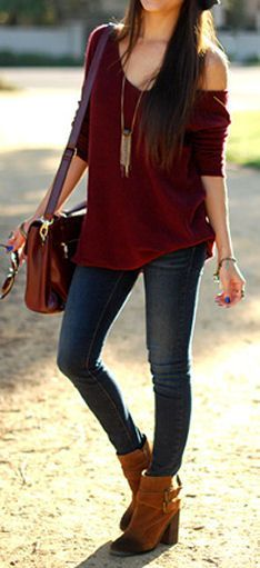 Oxblood jumper, blue jeans, brown boots