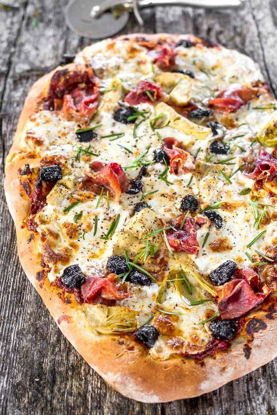 ... looking home-made pizza loaded with artichokes, olives and prosciutto