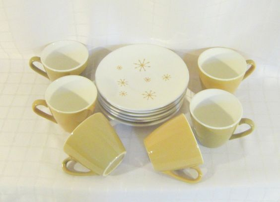 mustard yellow star glow cups and saucers (etsy shop: slatternhouse5)
