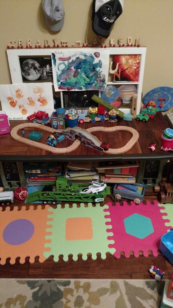 Kids playroom table, made with leftover acacia hardwood flooring, plywood, 2 old wooden crates, and leftover crown molding.  Total cost: $0