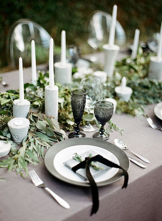 Create wedding centerpieces | bay leaf garland and white candles: