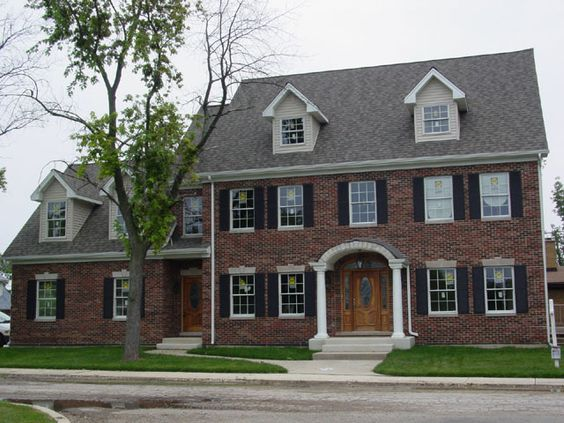 Colonial Style Brick Home With Elliptical Arch Portico