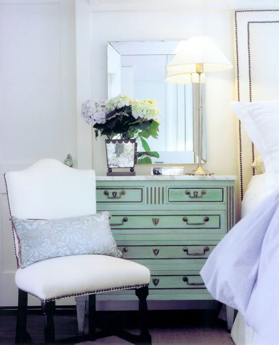 Ashley Goforth via House of Turquoise -similar but at Home Goods.  Bedroom nightstand./mirror/flowers/lamp/chair