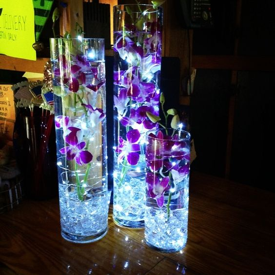 Submerged purple dendrobium orchids with underwater led