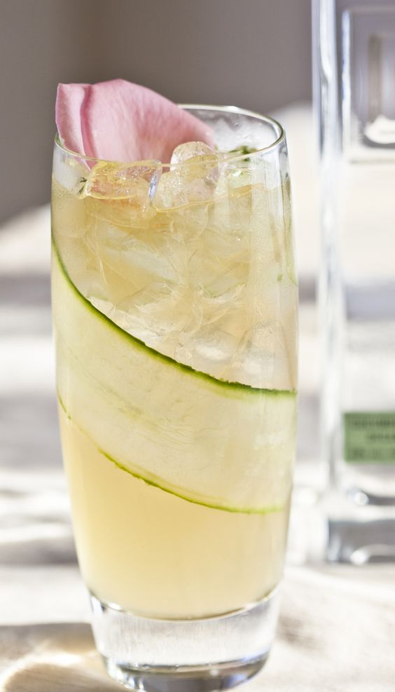 Beautiful for summer weddings! Aromatherapy with Square One Cucumber and a touch of rose water. Garnished with wrapped cucumber slice and edible flower. Recipe: http://www.squareoneorganicspirits.com/TownSquare/TS_MixologyArt/TS_cucumbercocktails.html