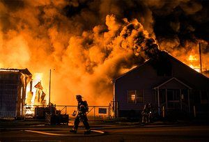 Firefighters tackle a blaze at a timberyard in Lemoyne, Pennsylvania Sean Simmers/AP via the Guardian newspaper