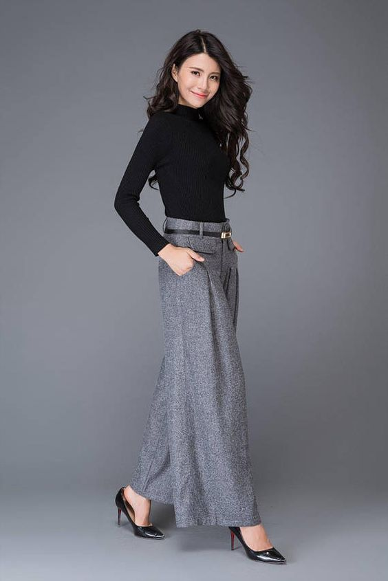 The Wide leg pants is made of wool blend and polyester The wool pants is closed by front zipper and buttons The pants has two side pockets. Shop sizing chart FYI ( made according to US sizing. actual body figures, NOT laying flat clothes measurements) SIZE (US 0, UK 4, Italian 34, French