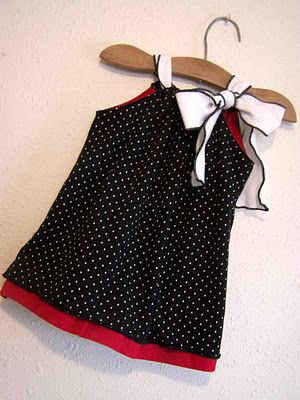 Sweet Pea Dress Pattern and Tutorial.  Love the black rolled hem on white knit fabric!