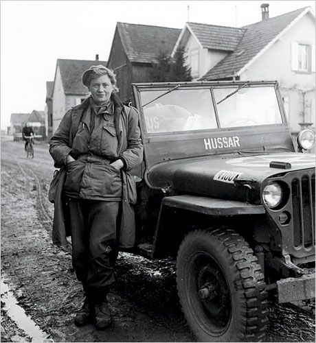 "Photographer Lee Miller poses for another shutterbug in front of their jeep. The female journalists and photographers went everywhere the men went, faced the same dangers, and brought home the same compelling stories. Once they convinced their publishers to let them write something other than ""women's pieces"", and convinced the military authorities to give them access."