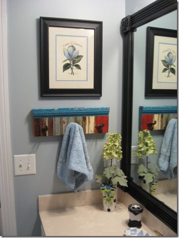 Frame plain mirrors with fluted moulding and rosette trim. Great look