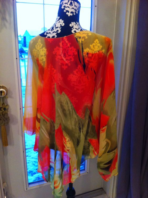 Such a great poncho style, sheer , lucyluwrap!!   Super cute over a camisole, tshirt or swimsuit.   Lucydesigns on fb