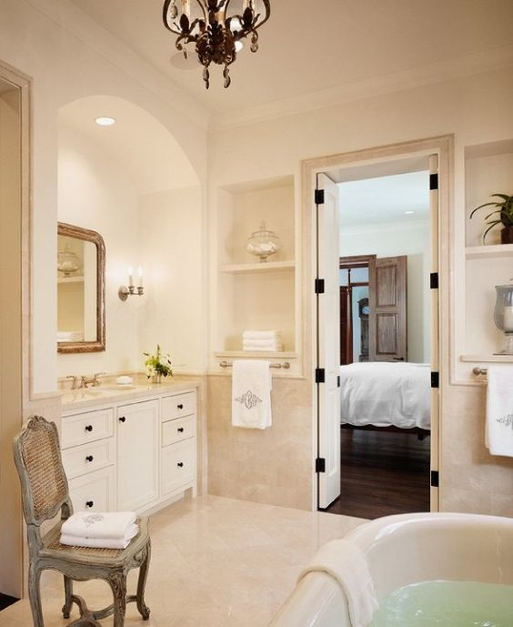 Dillon Kyle Architecture: Elegant bathroom with freestanding bath tub. Arched alcove with built-in vanity, gilt ...