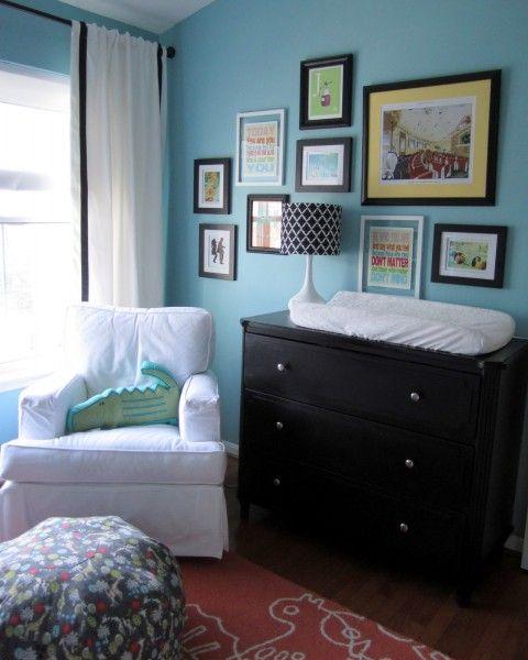 dark dresser with art wall