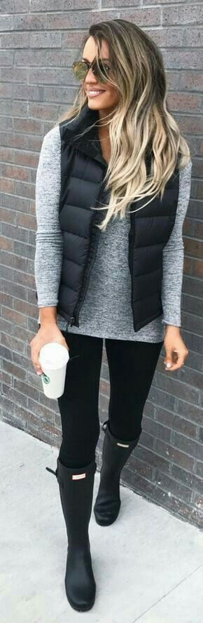Cozy grey sweater with black leggings and boots and vest.