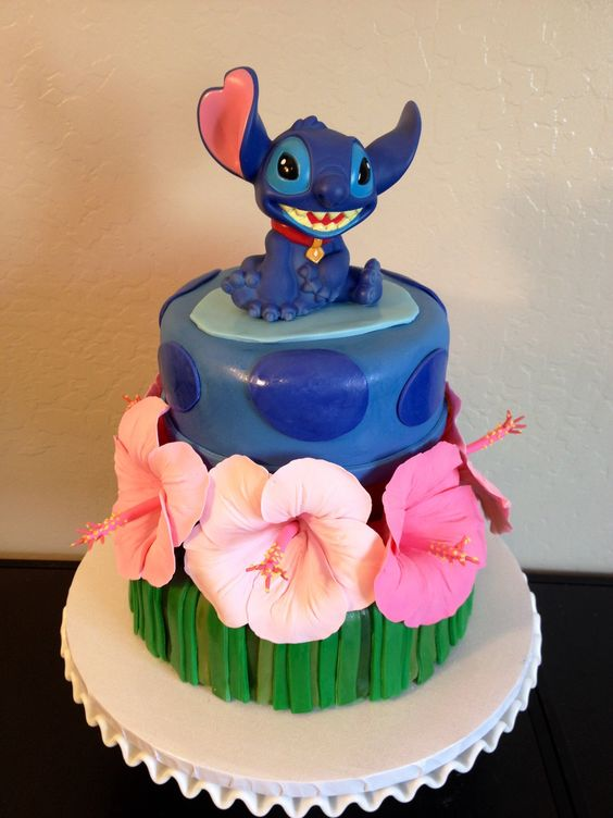 Lilo and Stitch cake with gum paste hibiscus flowers.