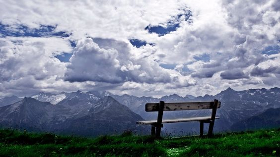 Incredible Photograph!  Can you imagine sitting for a day on that bench watching the sky & mountains, observing the light & shadows shift, how the colors & hues change as the earth rotates around the sun. It seems to me that it would be an awe-inspiring, almost-religious experience.