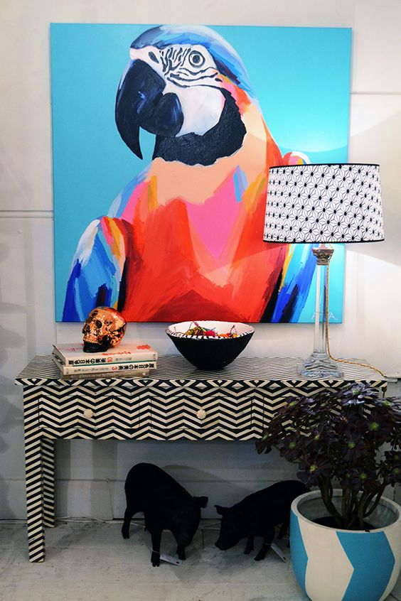 Make a bold statement with big, bright, paintings to liven up a dining space.: