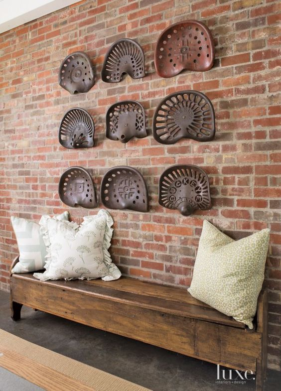 Barnes incorporated many of the homeowners' unique finds such as antique tractor seats set into an artful wall display in the foyer.