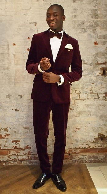 A deep, dark red velvet tux? Very Old Hollywood and very cool.: