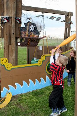 can make a ship out of cardboard and put against the back fence?