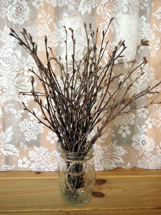 Twiggy woodland wedding table bouquet natural brown