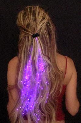Starlight Strands Illuminating Fiber Optic Hair Extensions & Rave Toy. Not that I have gone to a rave in 10 years, but it's still pretty damn fun.