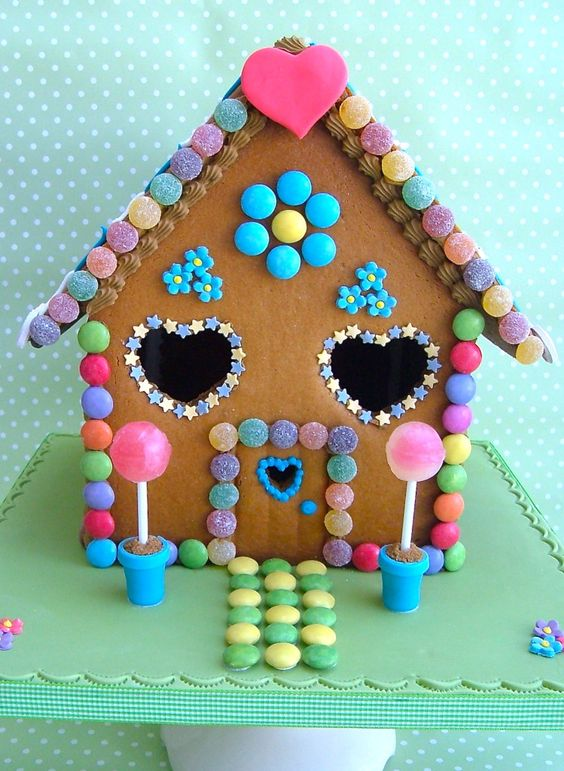 Adorable gingerbread house with hearts, stars, and pink
