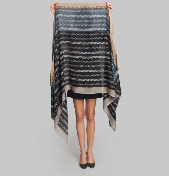 Black and blue wool scarf, chain mail grey print, fringed hems.      Adding a unique touch to your everyday accessories, Epice have created this stylish Chaîne