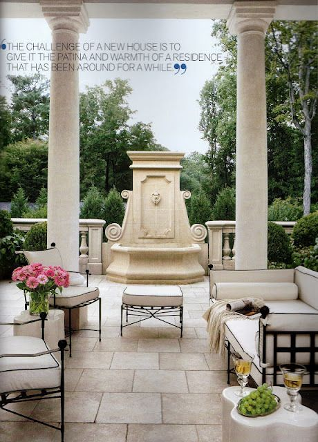 Beautiful carved stone fountain is the focal point in this outdoor space.  Clean lined furniture