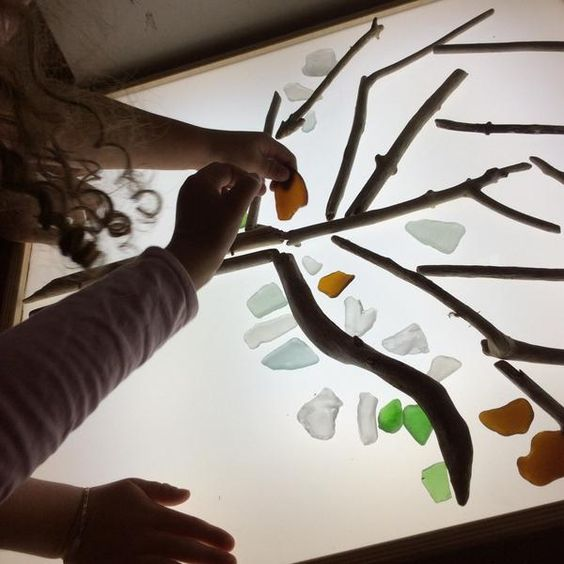 Tree with beach glass on light table-From Twitter-A Recipe For Wonder @wonderstaples
