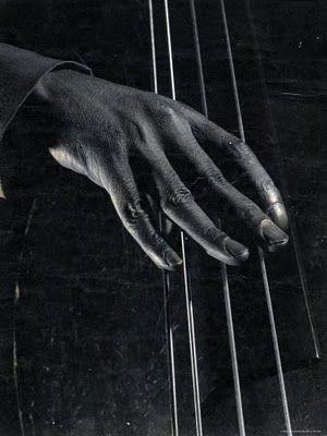 Jam Session: Hand of unident, bass player on the strings during jam session at photographer Gjon Mili's studio  By Gjon Mili, New York, 1943