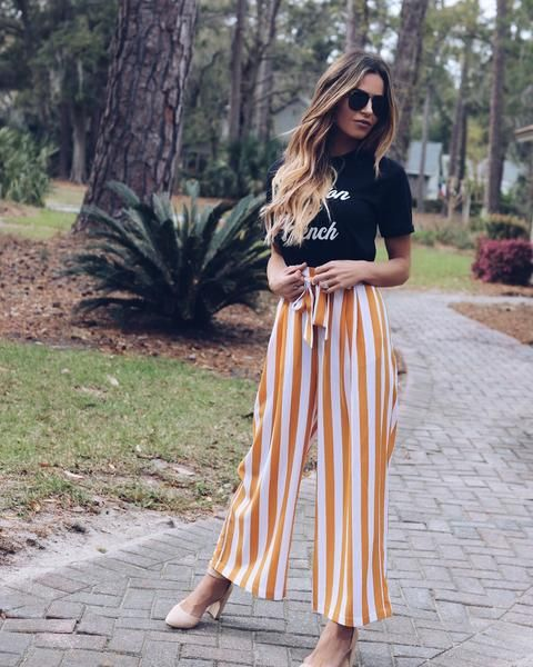 We can't get enough of this style! Thousand Suns Pocketed Striped Tie Pants are adorable in this mustard and off white striped print. The elastic waist is accompanied by a waist tie and pockets on these cute high waisted pants! Paired with our Pardon My French Tee and Manhattan Faux Suede Pointed Heel. Elastic Waist W