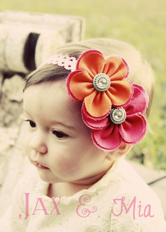 I would get this for Gianna if I knew she would keep it on her head. So cute!    Spring Couture Headband- $10.00.  jaxandmia.etsy.com