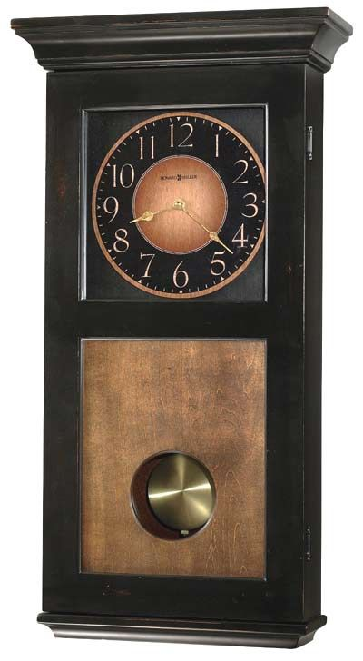 """This wall clock is finished in Worn Black with brown accents and features a Vintage Umber finished lower door panel, dial and back panel. The dial offers gold Arabic numerals on a brown and black background. An antique brass swinging pendulum may be viewed through a window in the front door panel. Quartz, dual chime movement plays Westminster or Ave Maria chimes, and features volume control and automatic nighttime chime shut-off option. Size: H. 27"""" W. 14-1/4"""" D. 5"""""""
